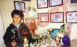 Sorana Cirstea alaturi de trofeele cucerite pana la 10 ani